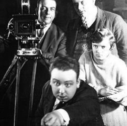 Young Alfred Hitchcock (Front) with wife Alma Reville (R)