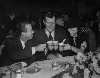 Andy Devine (center), Mrs. Devine and Norris Goff (Abner of Lum & Abner.)