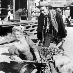 Claire Trevor and Randolph Scott Between Shots On The Desperadoes 1943