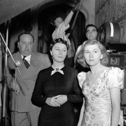 """Alfred Hitchcock on set of """"Rebecca"""" with Judith Anderson and Joan Fontaine"""