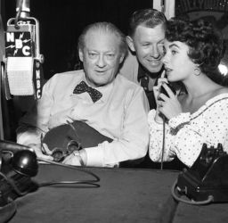 Lionel Barrymore (L) with George Murphy and Elizabeth Taylor
